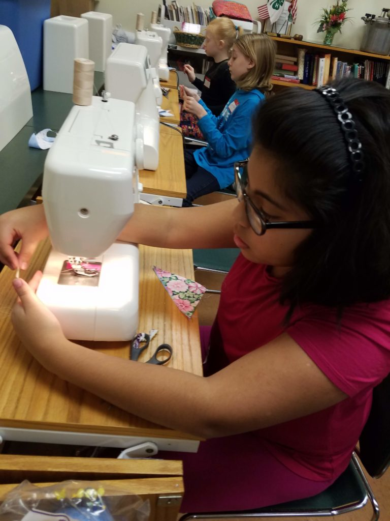 Young 4-Hers sewing
