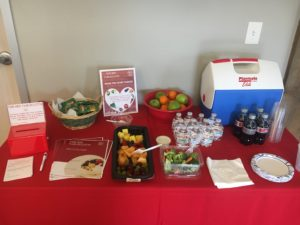 Cover photo for Lee County Promotes Heart Month With Red Tablecloth Initiative