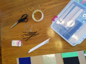 photo of tape, scissors, straws, etc (items that belong in a maker-space)